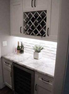 custom designed alcove with wine rack and refrigerator