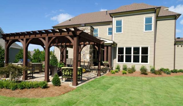 A patio with pergola and kitchen area enhance your outdoor living